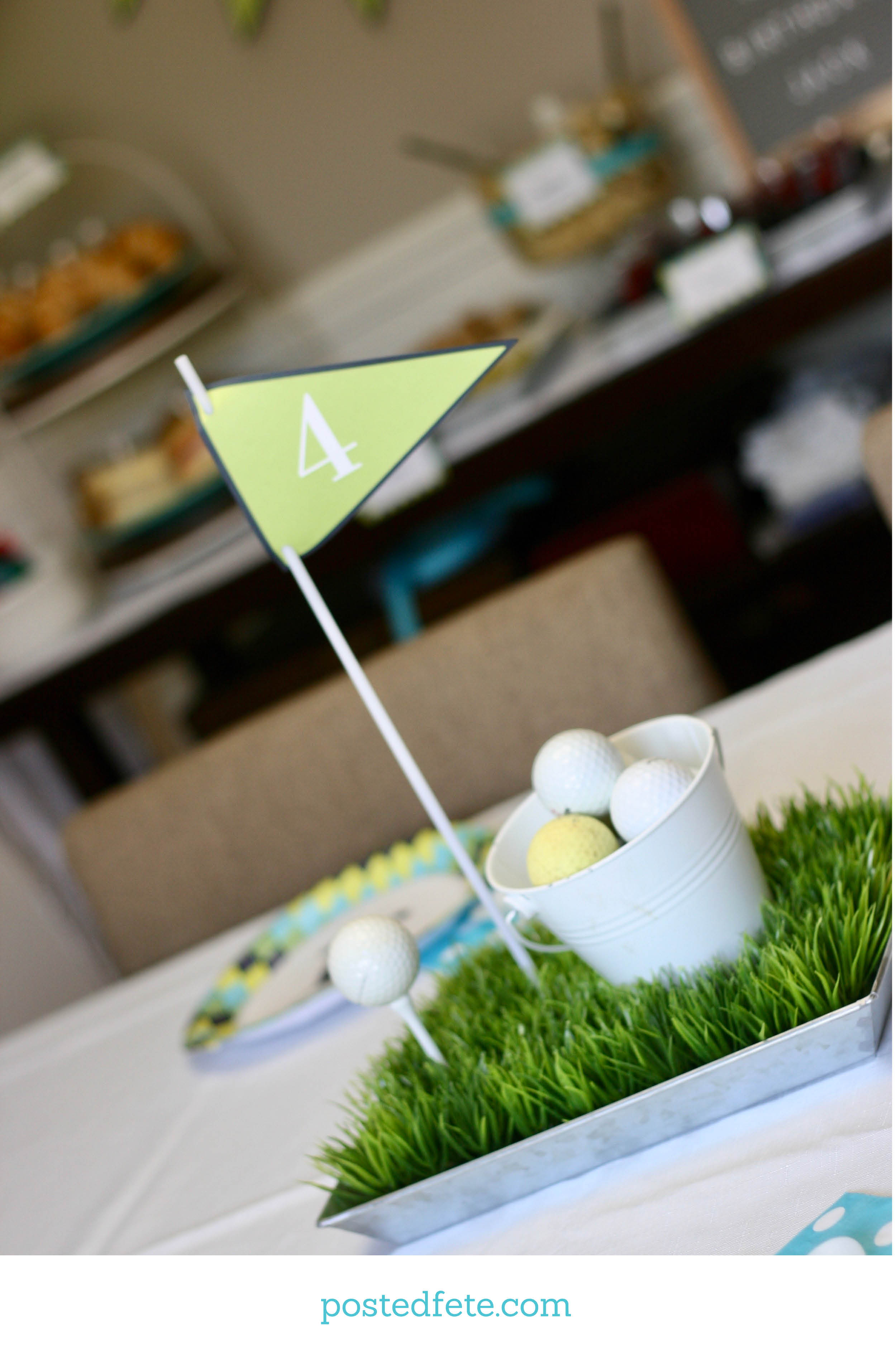 Golf Party Centerpiece Decoration with grass, bucket of balls, and golf flag
